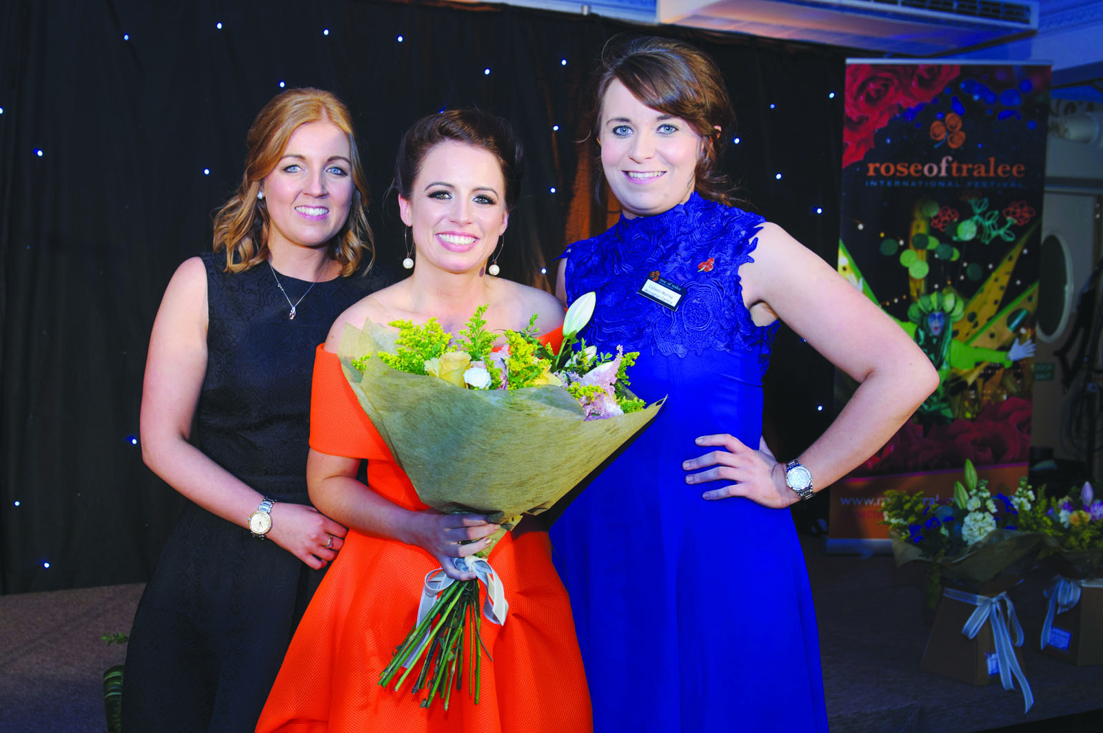 Monaghan Rose coordinators, Sonia Casey, left and Coleen Murray, making a presentation to 2015 Monaghan Rose, Michelle Caulfield, centre. ©Rory Geary/The Northern Standard