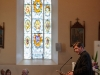 Monsignor Joseph McGuinness, Diocesan Administrator of the Diocese of Clogher, speaking at St Macartan's Church, at the event to unveil a plaque in honour of Archbishop John Joseph Hughes. In the background is a memorial stain glass window, which is dedicated to Archbishop John Joseph Hughes. ©Rory Geary/The Northern Standard