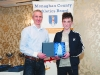 Chairman of the Monaghan County Athletics Board, Alan Clarke, left, making the presentation to Conor Maguire. ©Rory Geary/The Northern Standard