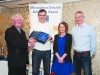 Eddie O'Gara, 2nd from left, accepting a presentation on behalf of Anthony Martin, Monaghan Phoenix AC, from Fr Paudge Corrigan. Also included are Rose Lambe and Chairman of the Monaghan County Athletics Board, Alan Clarke. ©Rory Geary/The Northern Standard