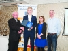 Fr Paudge Corrigan, making the presetation to Paul Peppard, Monaghan Phoenix AC. Also included are Rose Lambe and Alan Clarke, Chairman of the Monaghan County Athletics Board. ©Rory Geary/The Northern Standard