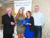 Leah Barry, 2nd from left, accepting the presentation on behalf of Niamh Malone, Monaghan Phoenix AC, from Rose Lambe. Also included are Fr Paudge Corrigan and Chairman of the Monaghan County Athletics Board, Alan Clarke. ©Rory Geary/The Northern Standard