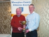 Patsy Kelly, left, making the presentation of the Cup for the 40-50 Mens Road League to winner, Alan Clarke, Blayney Rockets. ©Rory Geary/The Northern Standard