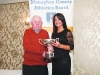 Winner of the Ladies 35-45 Road League, Elaine Walls, Carrick Aces, being presented with her cup by Patsy Kelly. ©Rory Geary/The Northern Standard