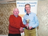 Winner of the Mens 50+ Road League, Mark Macklin, Monaghan Town Runners, being presented with the cup by Patsy Kelly. ©Rory Geary/The Northern Standard