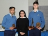 Suzanne McGinnity, making the presentation of the Senior Handballer of the year Awards to Hubert Scheinback, right, and Mohammed Abrahim. ©Rory Geary/The Northern Standard