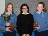 Suzanne McGinnity, making the presentation of the Junior Girl Handballer of the Year Awards to Karolina Kaklauskas, left and Caoimhe Mc Carra. ©Rory Geary/The Northern Standard
