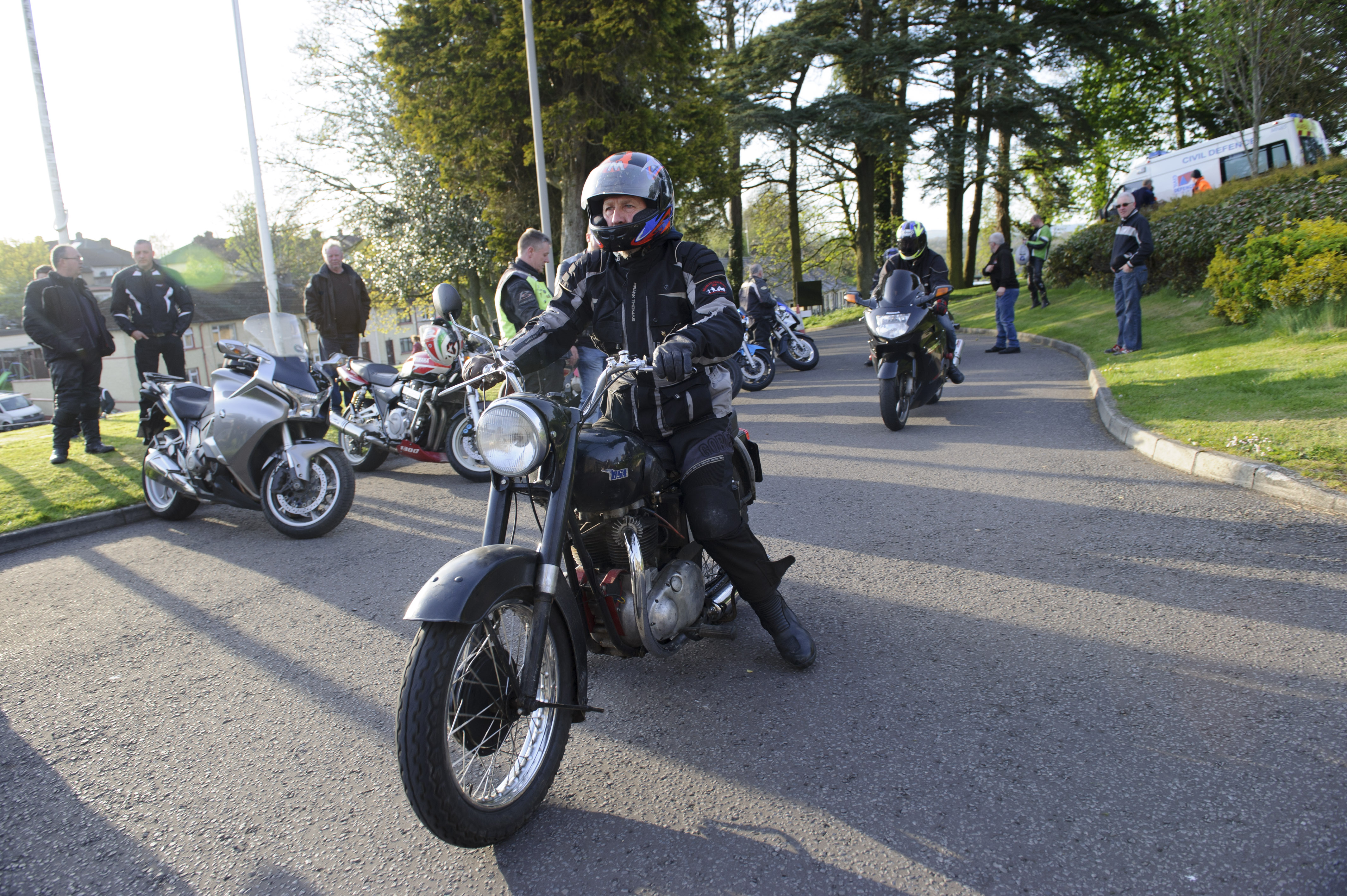 One of the patrons of the mass arriving by motorbike. ©Rory Geary/The Northern Standard