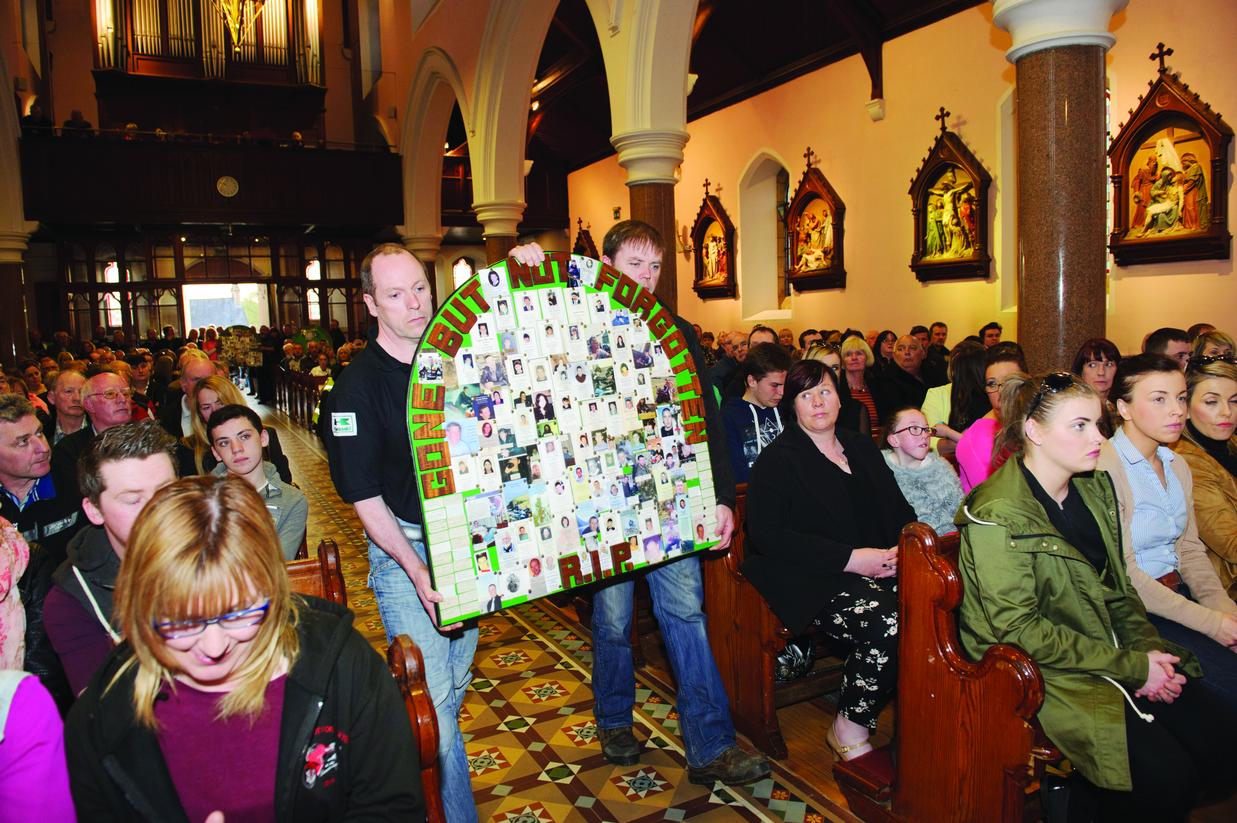The Gone But Not Forgotten Bikers plaque is brought to the alter during the mass in Clones last Friday. ©Rory Geary/The Northern Standard
