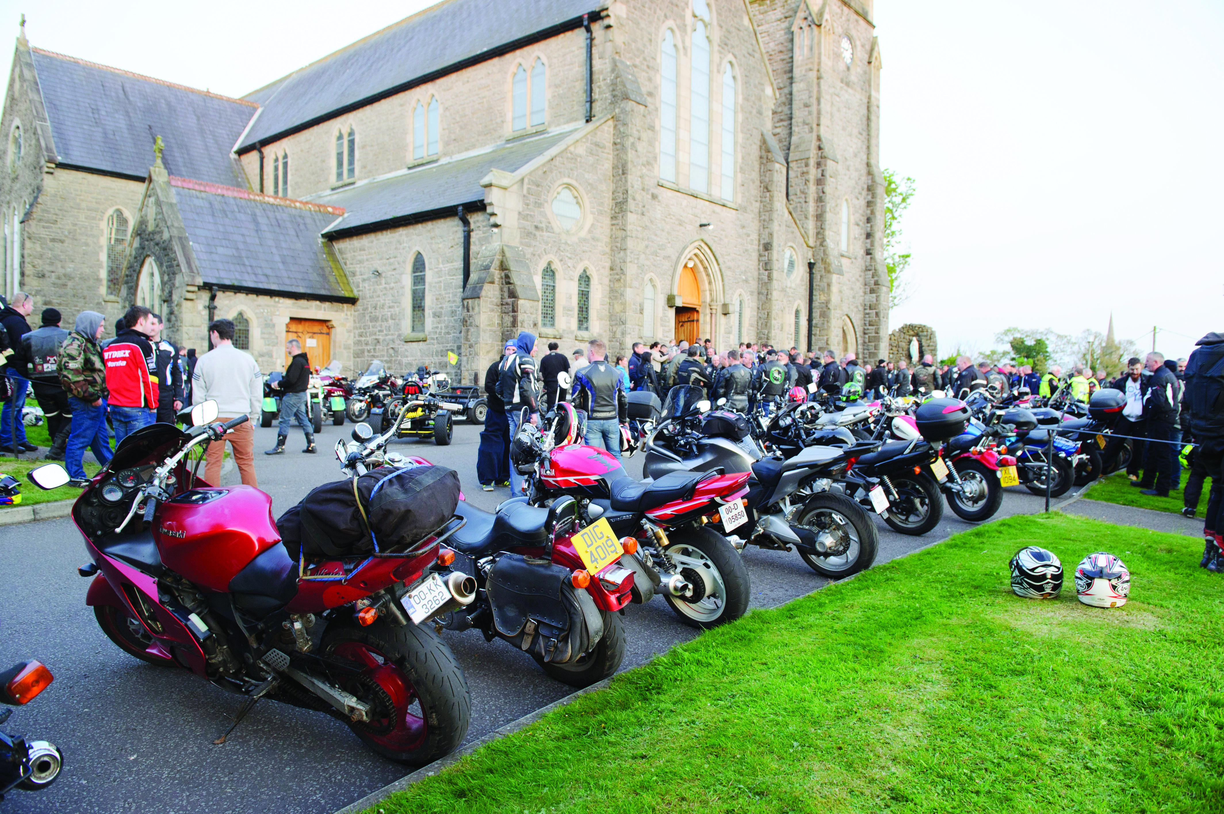 A line-up of motorbikes outside the church during the Gone But Not Forgotten Bikers Mass. ©Rory Geary/The Northern Standard