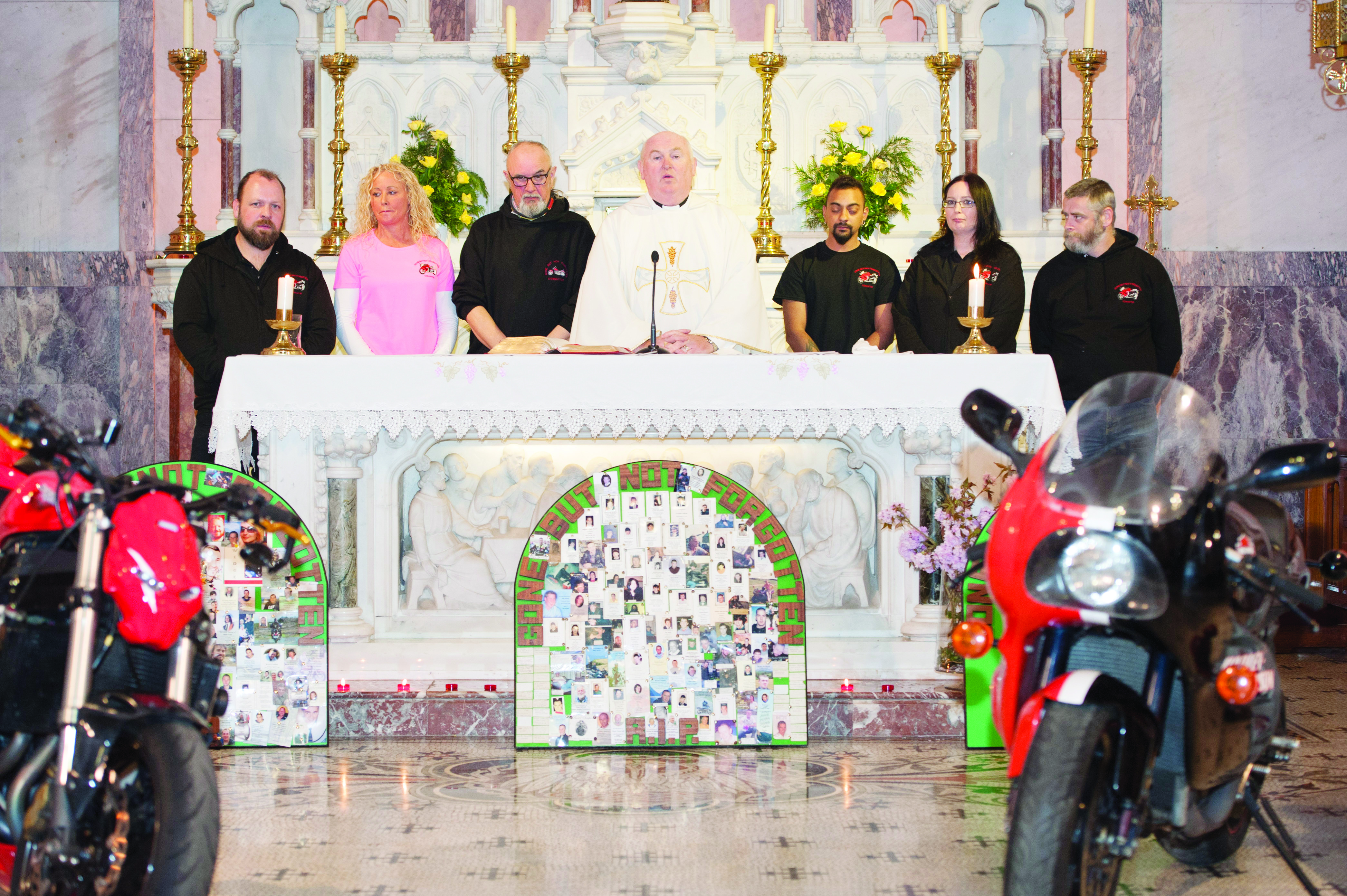 Some of the members of the committee of the Gone But Not Forgotten Bikers Mass on the alter with FR John Kierans were (L-R) Kieran Brennan, Teresa Boyle, Vinny West, Fr John Kierans, Jason Marshall, Ann Marie Marshall and Brian Mac Uaid. Missing from photo is John James McDonnell. ©Rory Geary/The Northern Standard