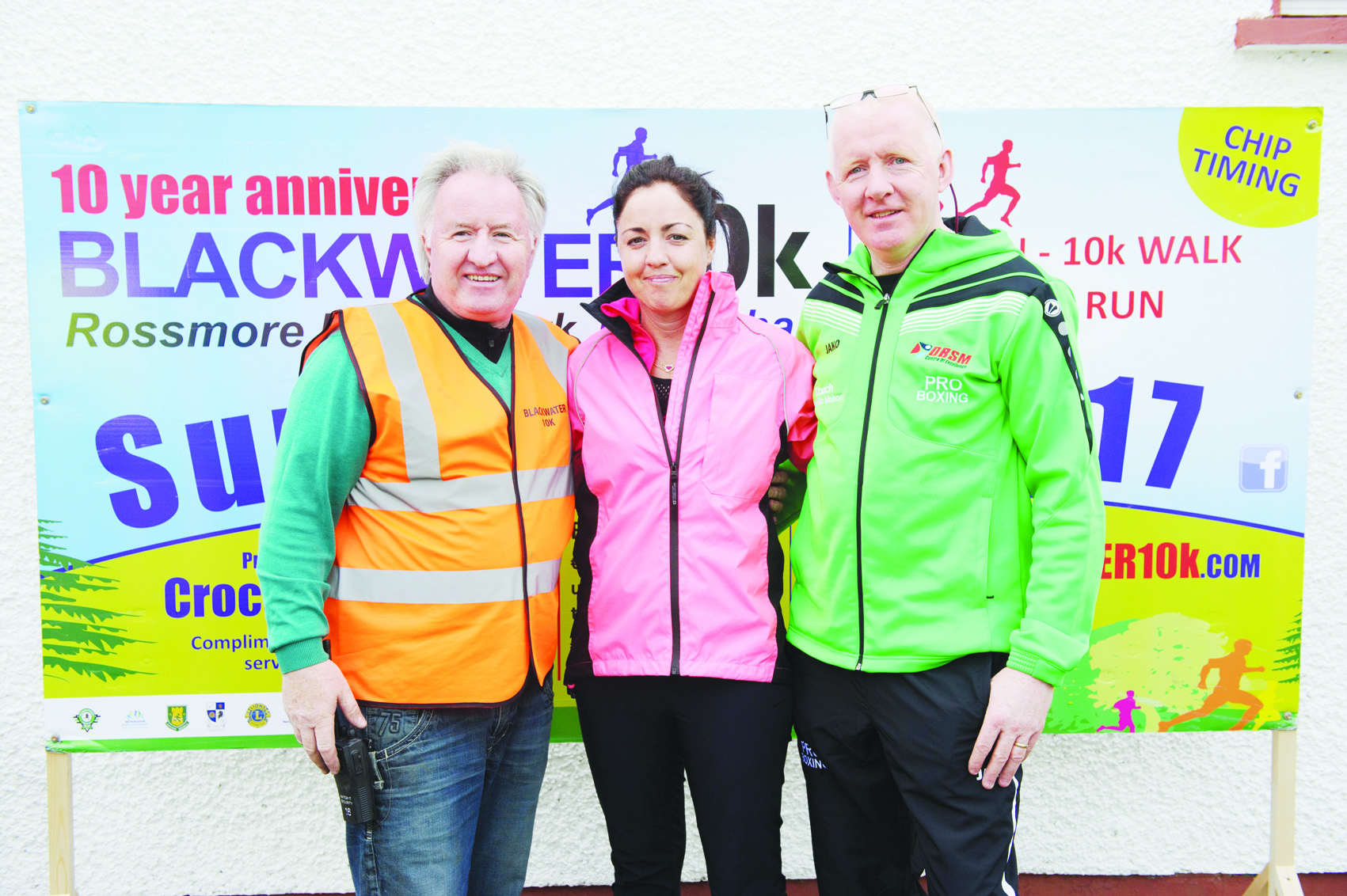 Christine McMahon, who got the runners warmed up for the Blackwater 10k, with Eamon Hackett, left and Frick McMahon. ©Rory Geary/The Northern Standard