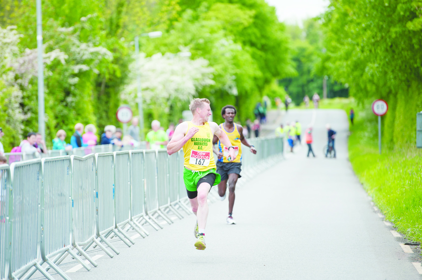 Christopher McGuirk, Glaslough Harriers, looks over his shoulder as he reaches the finish line just ahead of Eskander Turki, Monaghan Town Runners, to claim 3rd place. ©Rory Geary/The Northern Standard