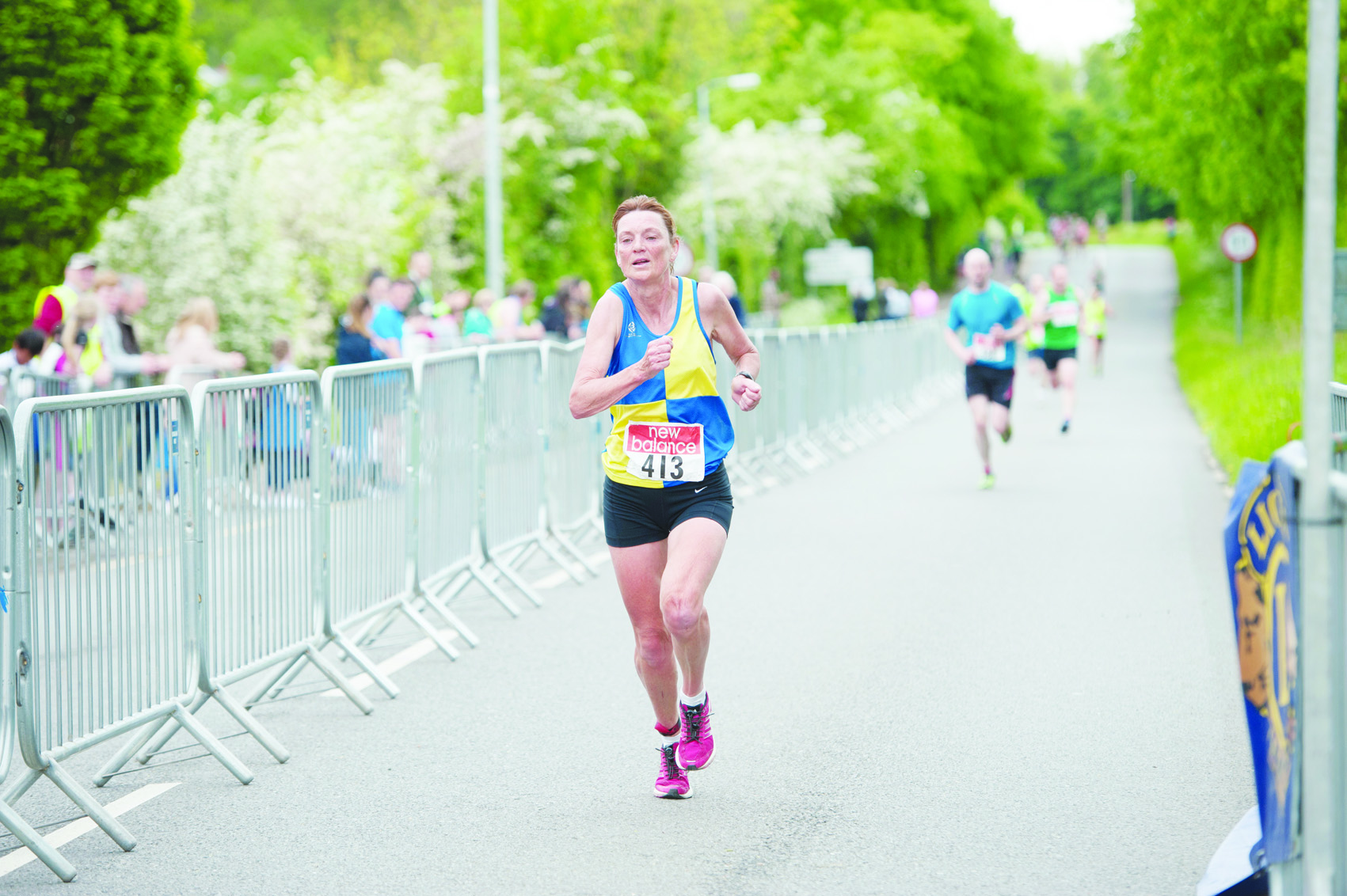 Donna Evans, Clones AC, crossing the line in 2nd place of the ladies race. ©Rory Geary/The Northern Standard