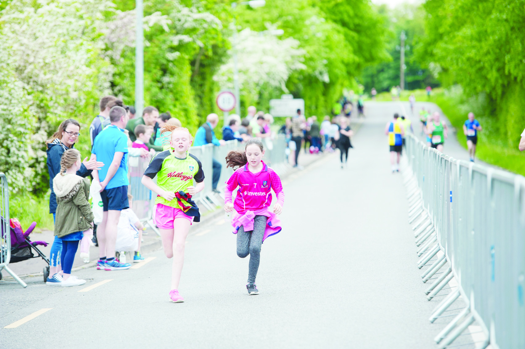 2 girls finishing the 5k run. ©Rory Geary/The Northern Standard