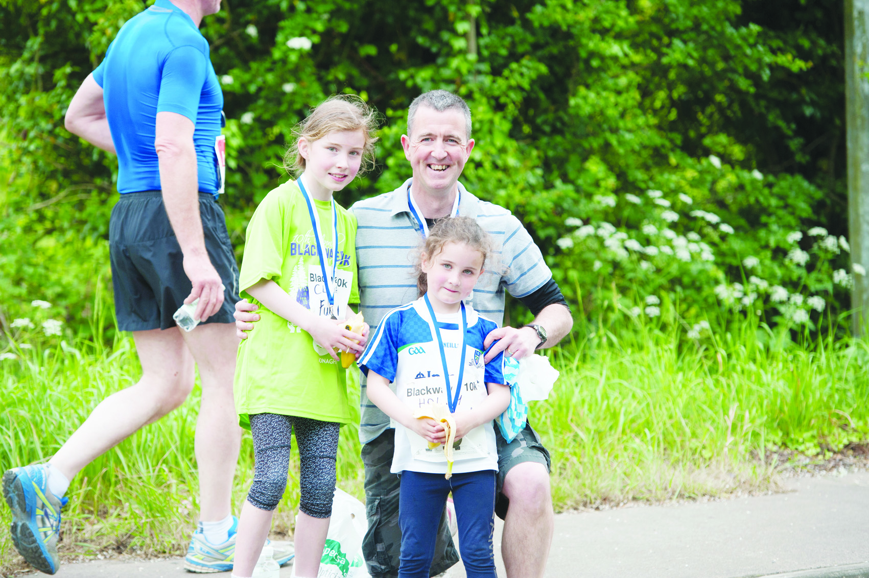 Colm Murphy and daughters after the fun run. ©Rory Geary/The Northern Standard