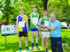 Peter McKenna, right, making the presentation of the prizes for the 3k funrun to winner, Andrew McKenna, centre, Monaghan Phoenix AC, Jamie McMahon, left, Clones AC, 2nd and Oisin Fagan, right, Monaghan Phoenix AC, 3rd. ©Rory Geary/The Northern Standard