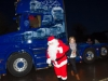 Rosemary Coyle welcoming Santa to Carrickroe last Sunday evening. ©Rory Geary/The Northern Standard