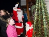 Santa switching on the Carrickroe Christmas lights, when he visited the village last Sunday evening. ©Rory Geary/The Northern Standard