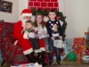 Shane, Emma and Adam McKenna with Santa at Carrickroe last Sunday. ©Rory Geary/The Northern Standard