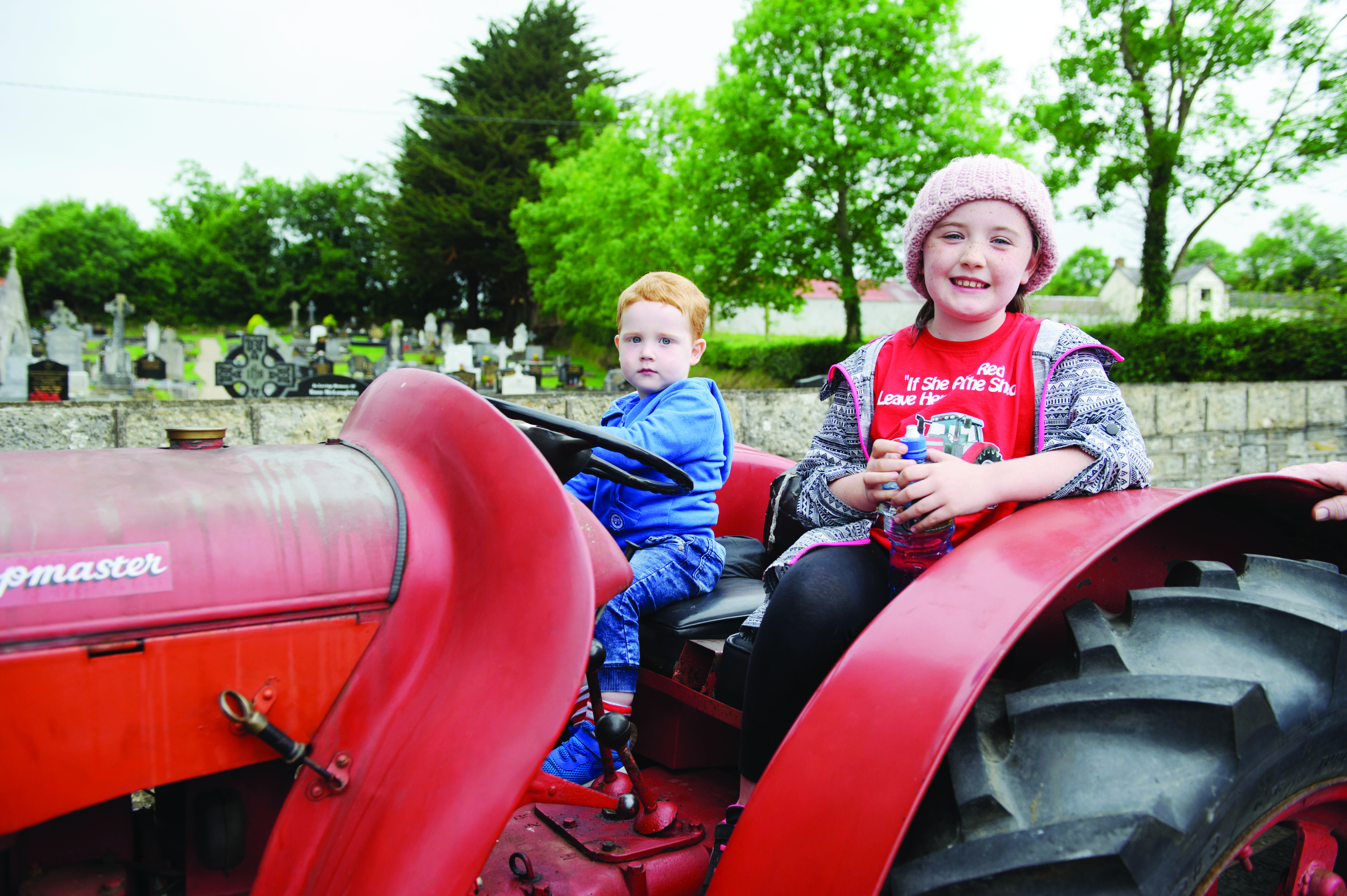 Ryan McPhillips and Kayla Treanor on one of the vintage tractors at the Carrickroe Welcome Home Festival tractor run. ©Rory Geary/The Northern Standard