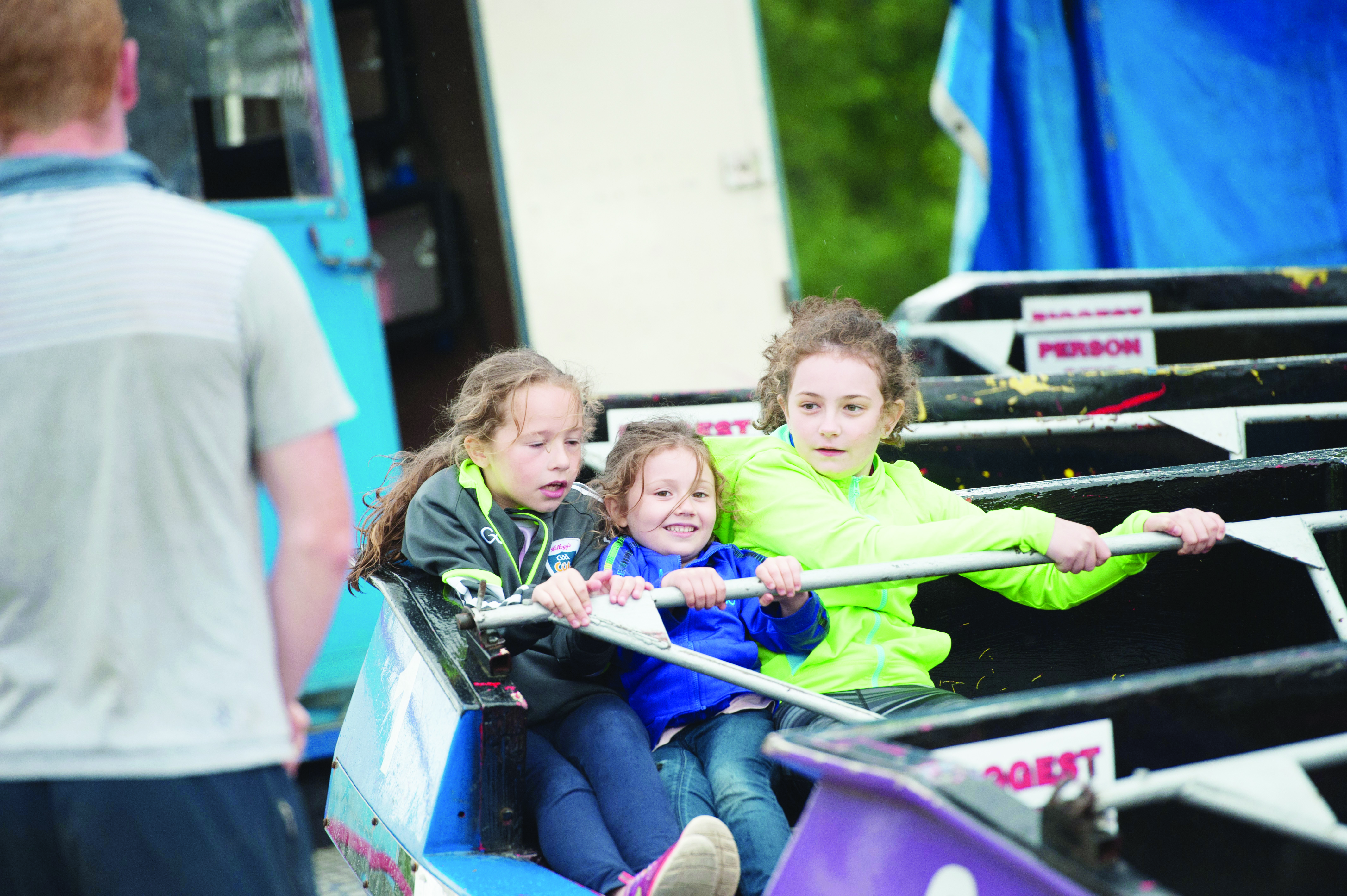 Some of the crowd on one of the fairground rides at the Carrickroe Welcome Home Festival sports day. ©Rory Geary/The Northern Standard