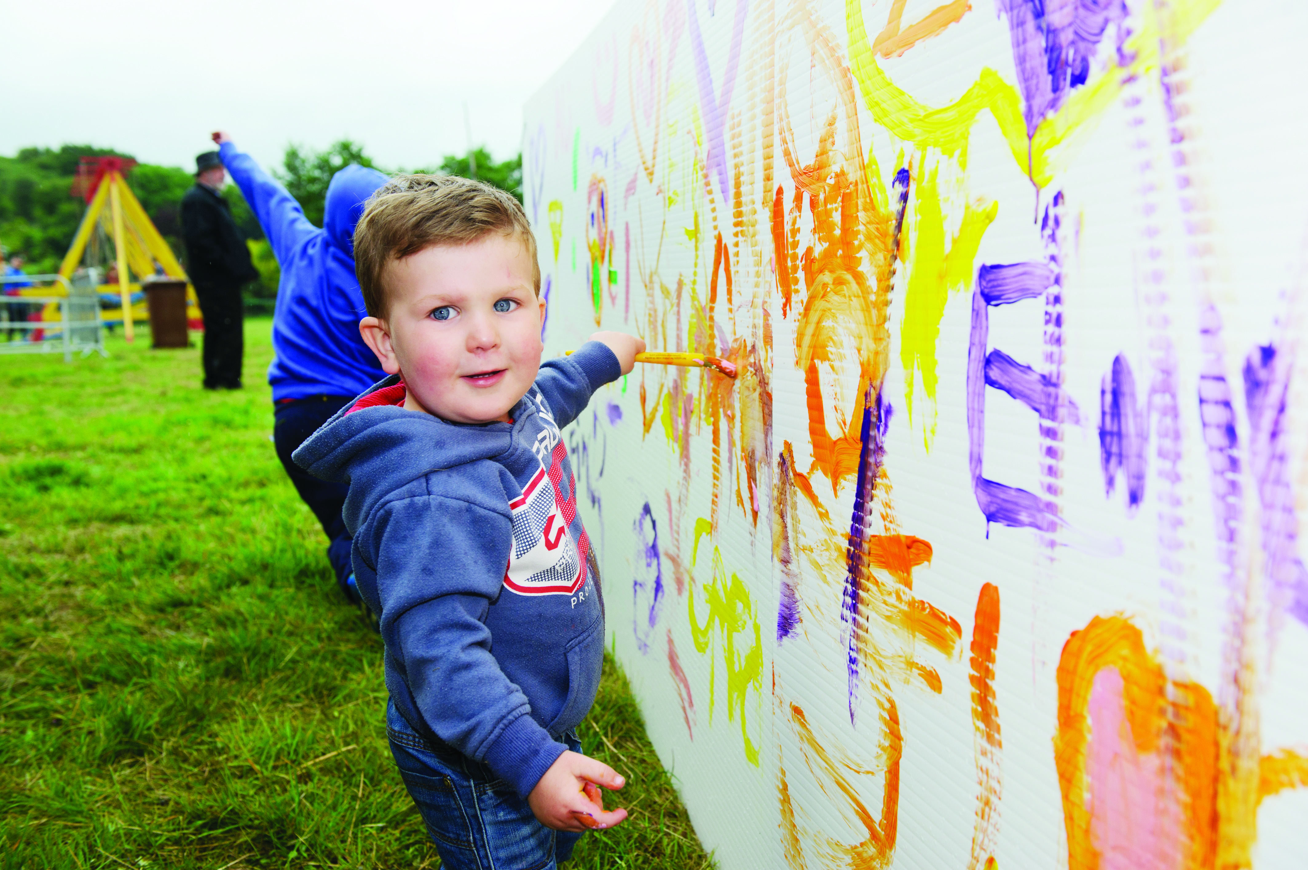Ruadh Curley painting during the sports day at Carrickroe Welcome Home Festival. ©Rory Geary/The Northern Standard