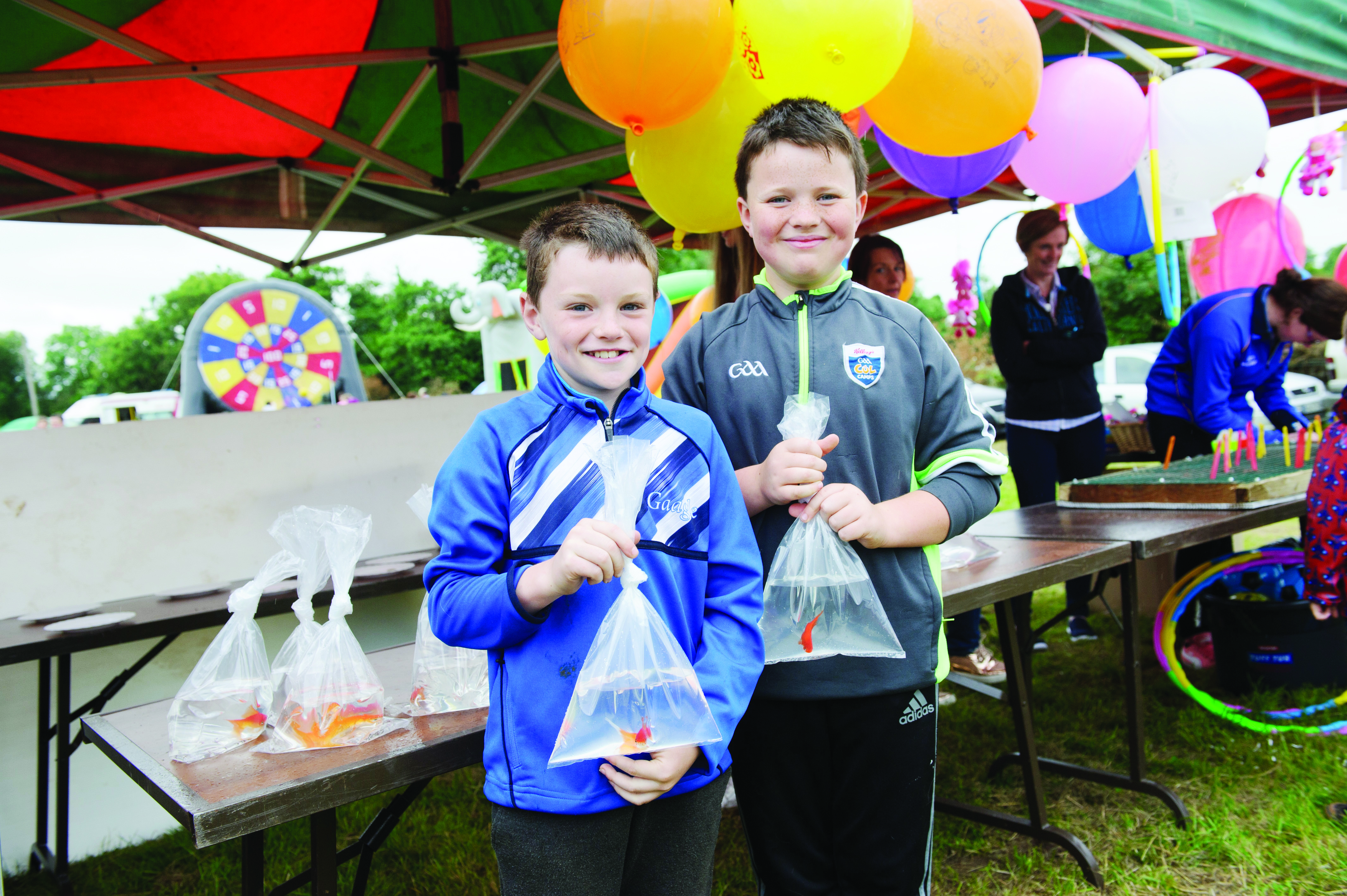 Luke McKenna and Donnacha McCluskey, with goldfish that they won at the Carrickroe Welcome Home Festival. ©Rory Geary/The Northern Standard