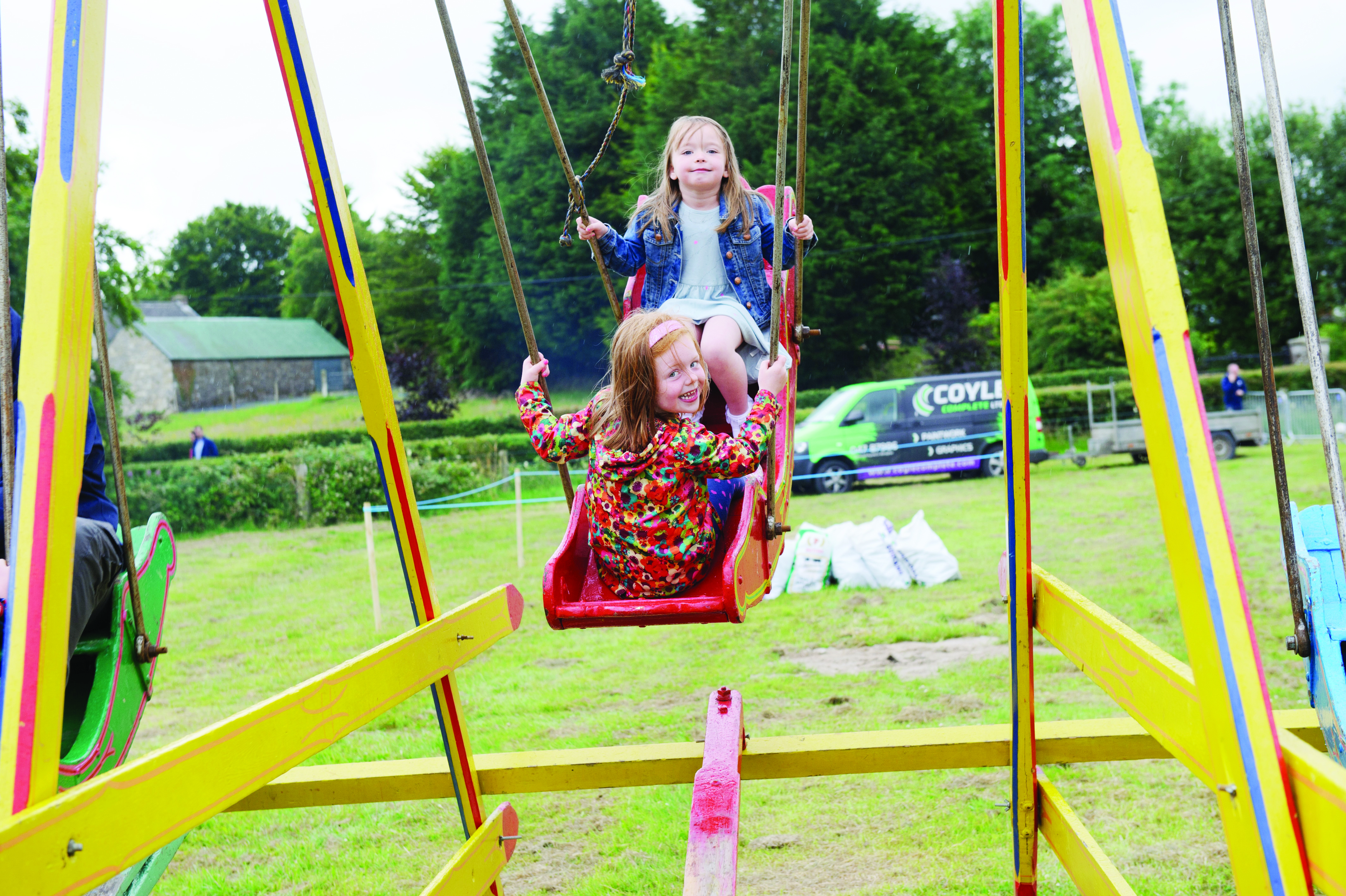 Anna McElroy and Lucy O'Neill on the swingboats at the Carrickroe Welcome Home Festival. ©Rory Geary/The Northern Standard