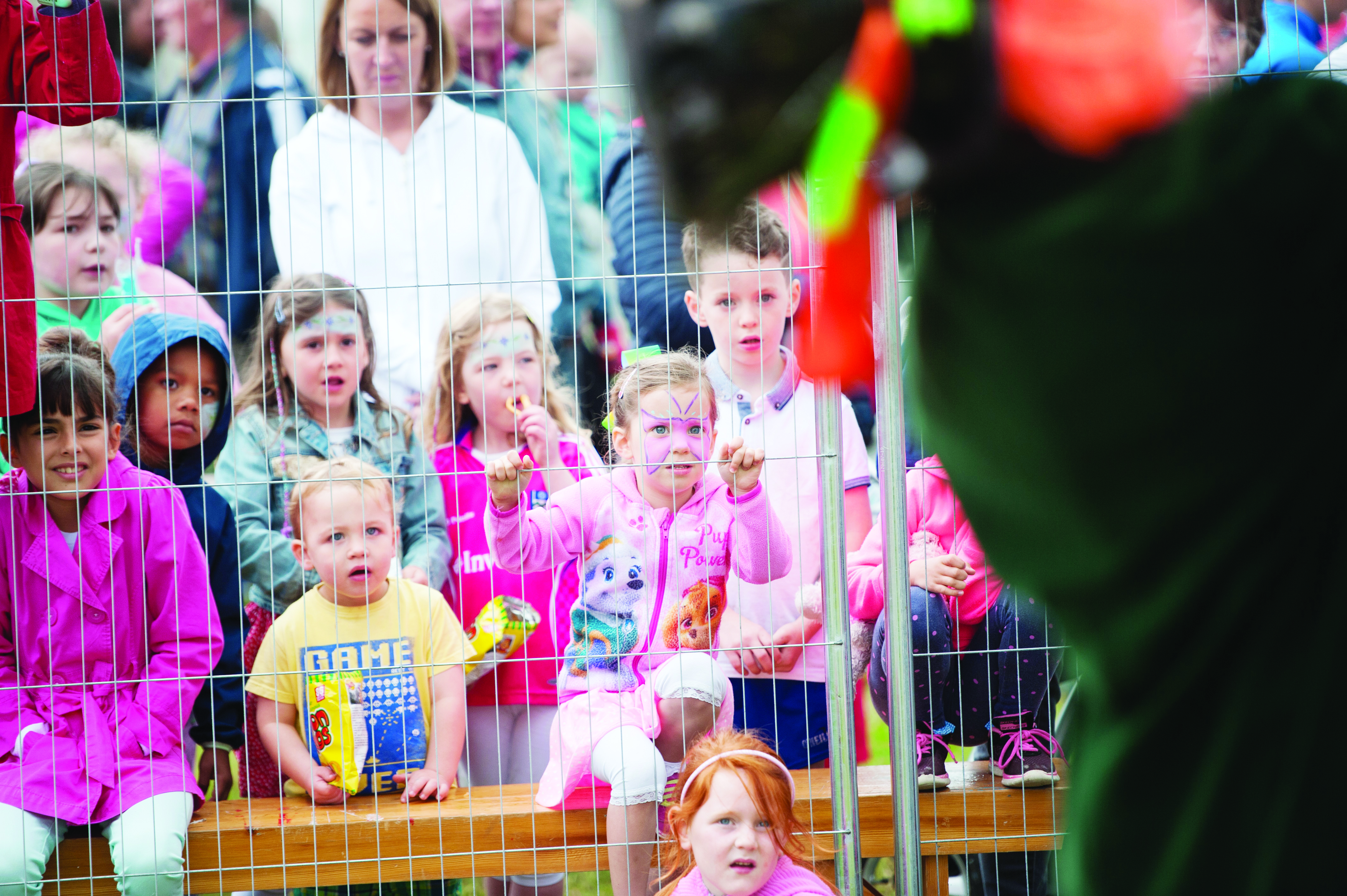 Some of the children watching a fire-eating act by the Corvenieos at the Carrickroe Welcome Home Festival. ©Rory Geary/The Northern Standard