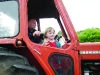 One of the participants in the tractor run waving to the crowd at the Carrickroe Welcome Home Festival. ©Rory Geary/The Northern Standard