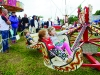 Some of the children on one of the fairground rides at the Carrickroe Welcome Home Festival. ©Rory Geary/The Northern Standard