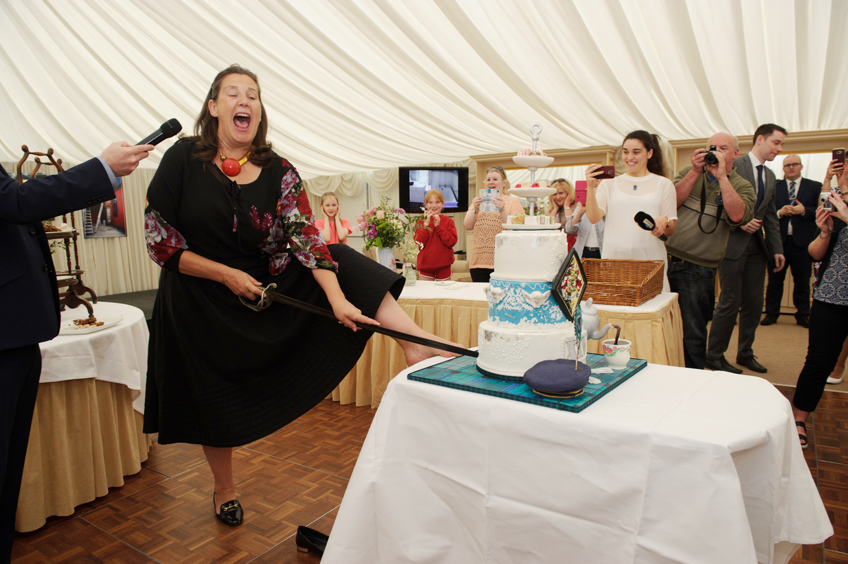 Sammy Leslie cutting the cake at the victorian tea-party to celebrate the 25th anniversary of the opening of the tea-rooms at Castle Leslie. ©Rory Geary/The Northern Standard