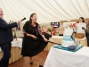 Sammy Leslie cutting the cake at the victorian tea-party to celebrate the 25th anniversary of the opening of the tea-rooms at Castle Leslie. On left is Brian Baldwin, manager of the Castle Leslie Estate. ©Rory Geary/The Northern Standard