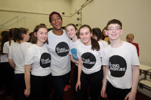 John from The Young Americans, with some of the group that took part in the performance at Castleblayney College. ©Rory Geary/The Northern Standard