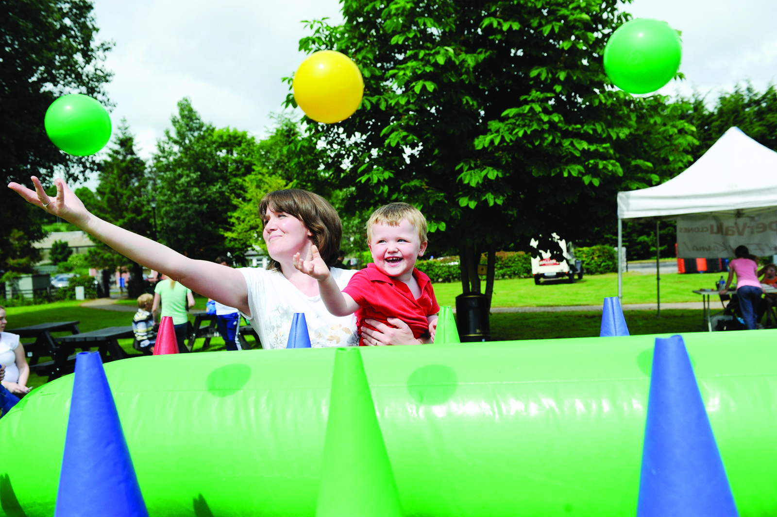 Nicola and Jamie McKenna playing with one of the attractions at the Clones Canal Festival. ©Rory Geary/The Northern Standard