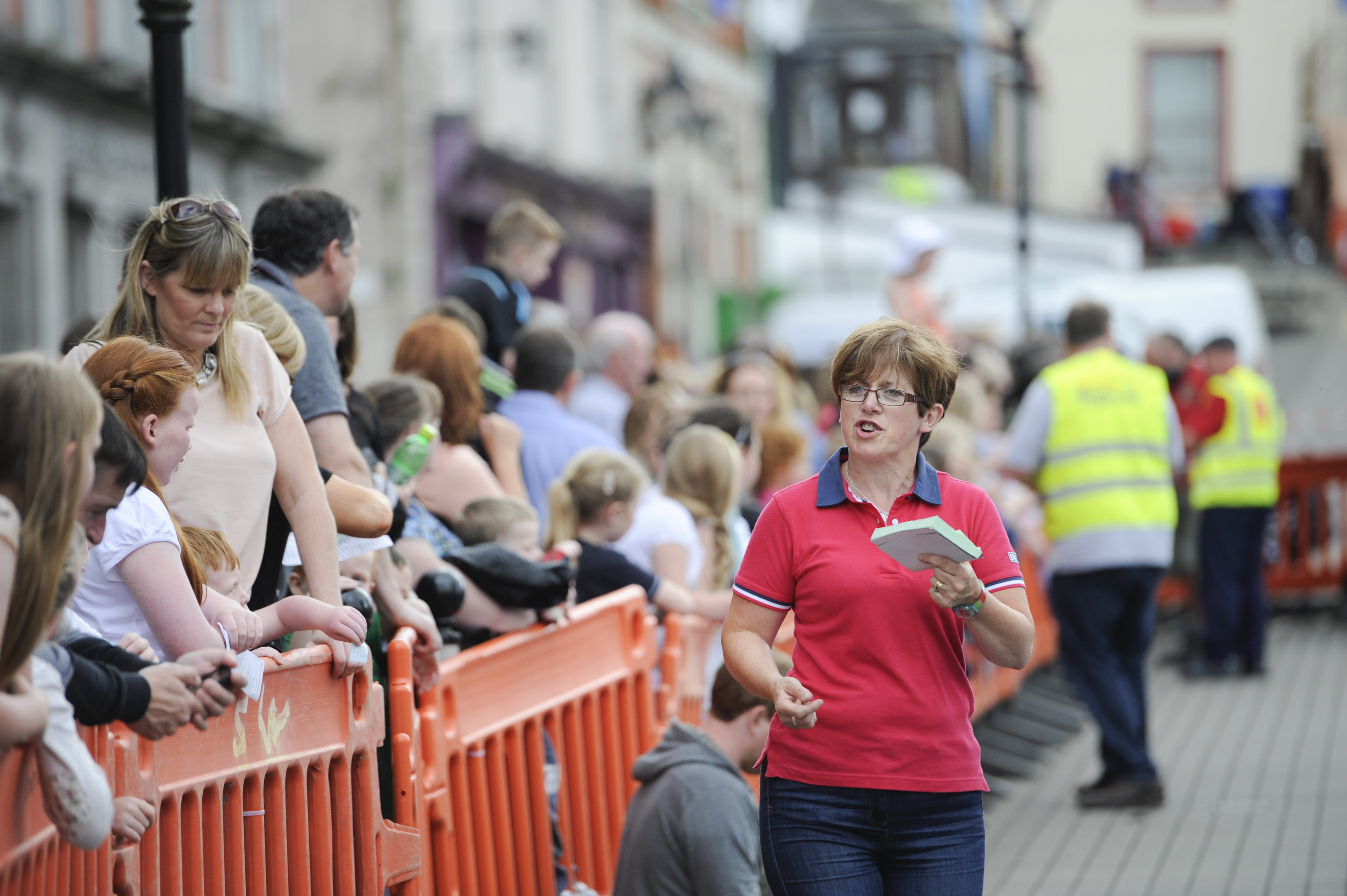 Joanne rehill selling tickets at the pig racing event. ©Rory Geary/The Northern Standard