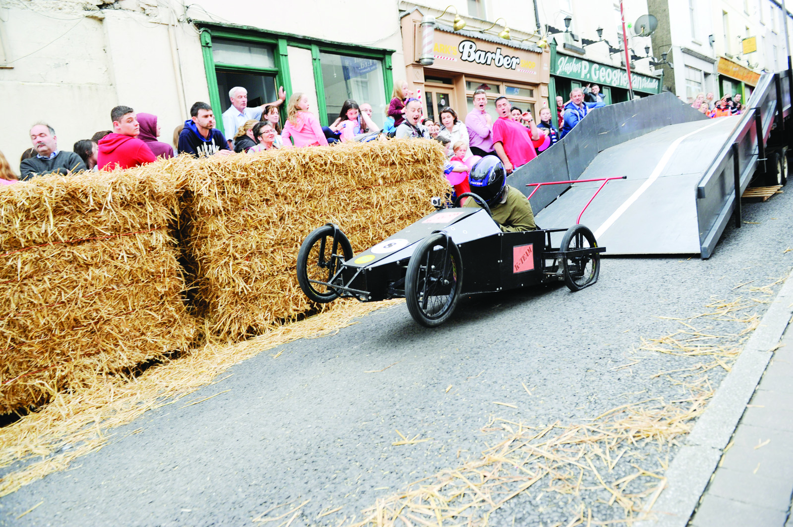 Winner of the Clones Canal Festival soapbox races, Ken Doonan buckling a wheel as he lands during one of his runs. ©Rory Geary/The Northern Standard