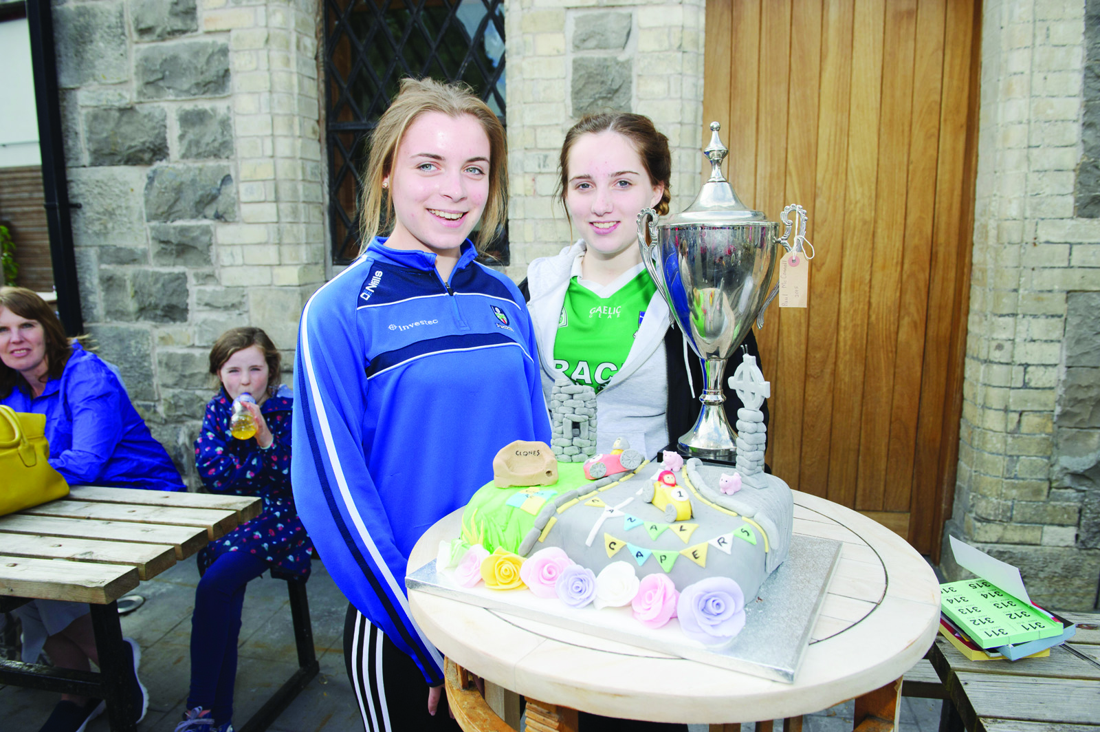 Lorainne Boyle and Christina Beggan with the cake that Claire Aspell made for the Clones Canal Festival. ©Rory Geary/The Northern Standard
