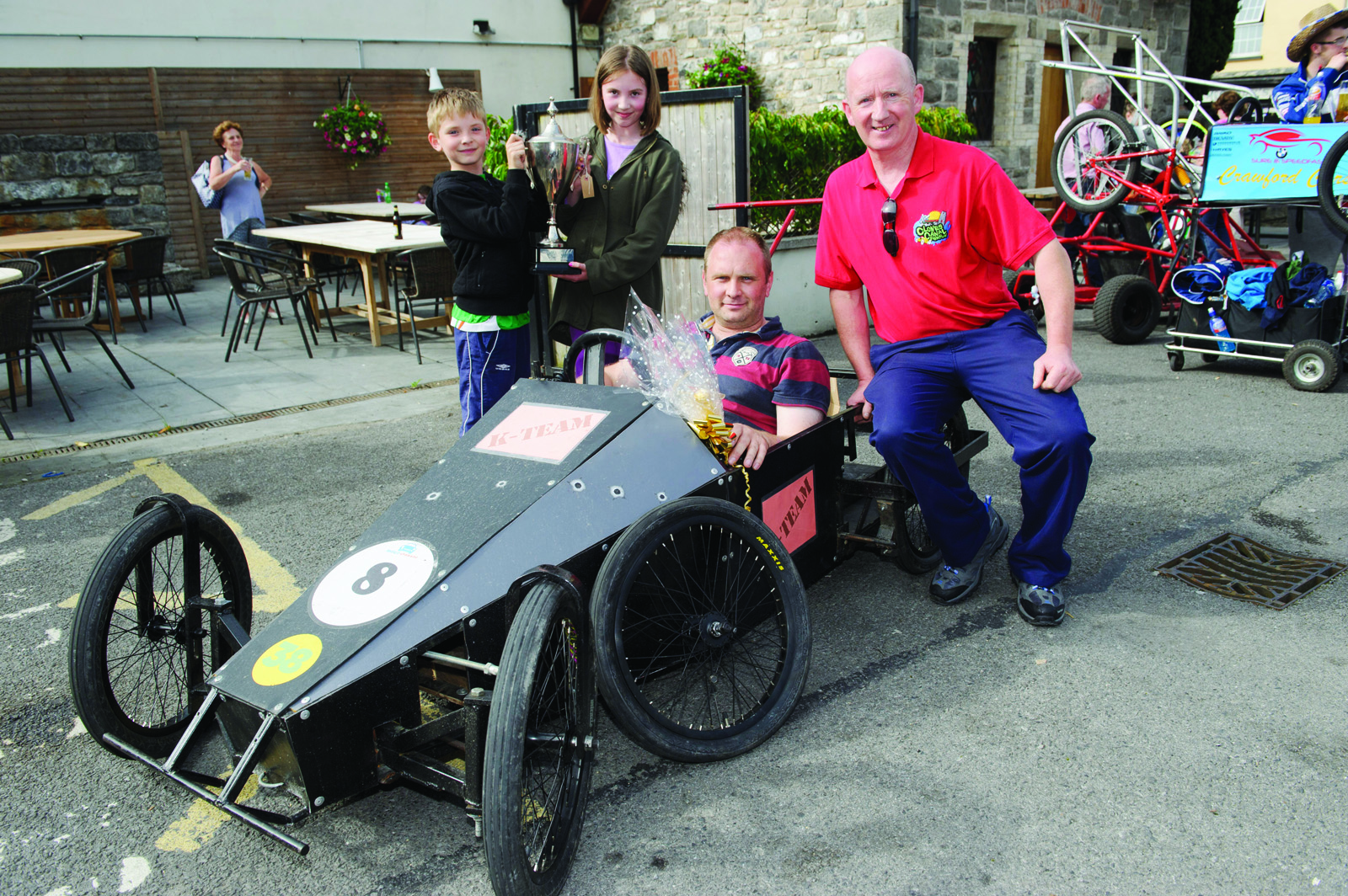 At the presentation of the cup to the winner of the Clones Canal Festival Soapbox races to Ken Doonan were (L-R) Jack and Amy Doonan, Ken Doonan and Padraig Geoghan, Clones Credit Union. ©Rory Geary/The Northern Standard