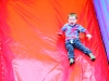 One of the children on a boucey slide at the Clones Canal Festival. ©Rory Geary/The Northern Standard