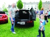 Darren and Junior McQuillian checking out one of the new mini's at the Clones Canal Festival. ©Rory Geary/The Northern Standard