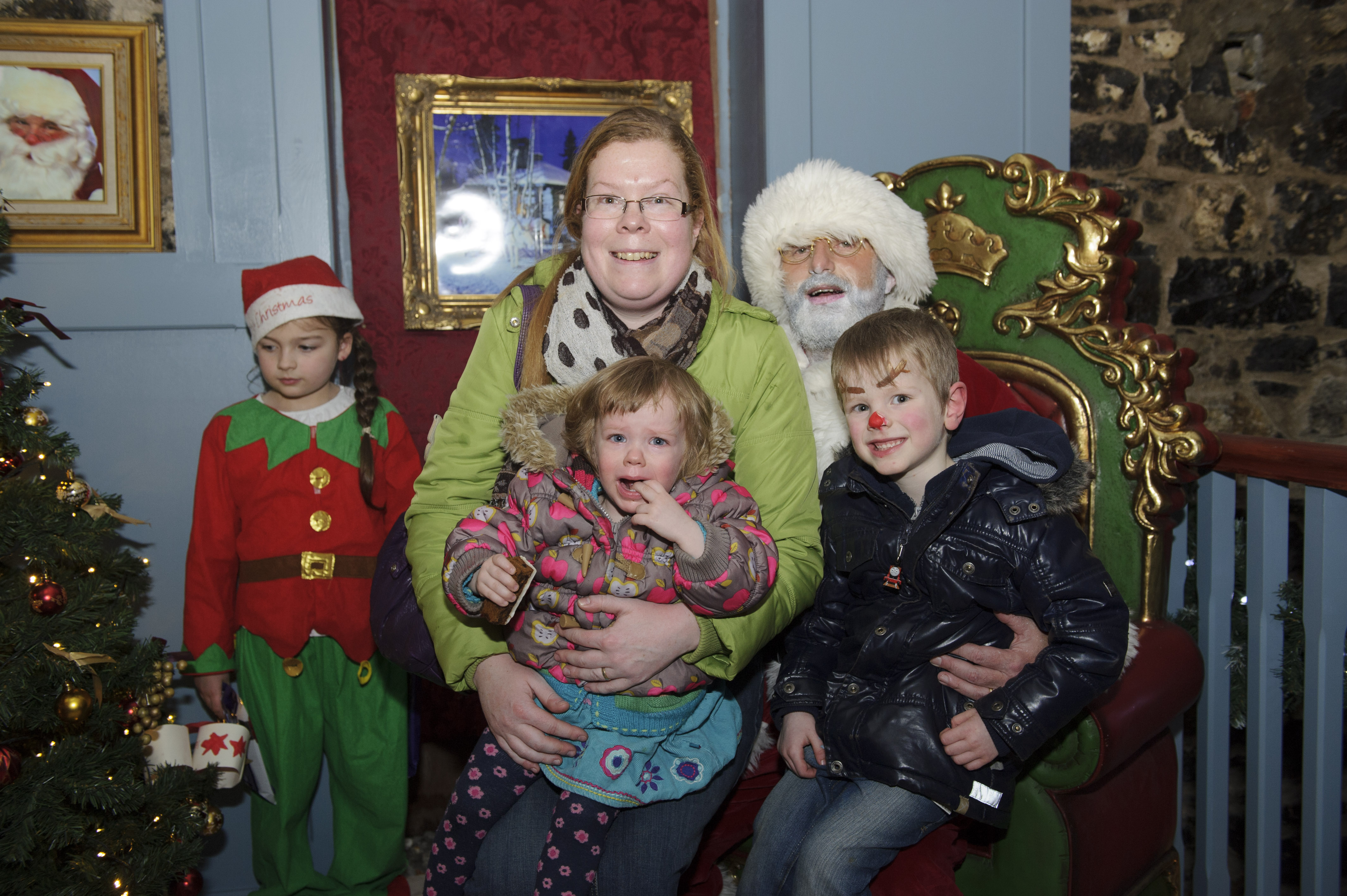 Ruth, Ethan and Hanna Francey with Santa, when he visited Clones, with support from Supervalu Clones. ©Rory Geary/The Northern Standard