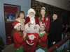 Santa making the draw for the winning ticket in the Clones Community Forum Christmas draw. Included are Josephine McKenna, Cathy Kirke, Cassandra Hand Queen and Mary Cosgrove, Clones Community Forum. ©Rory Geary/The Northern Standard