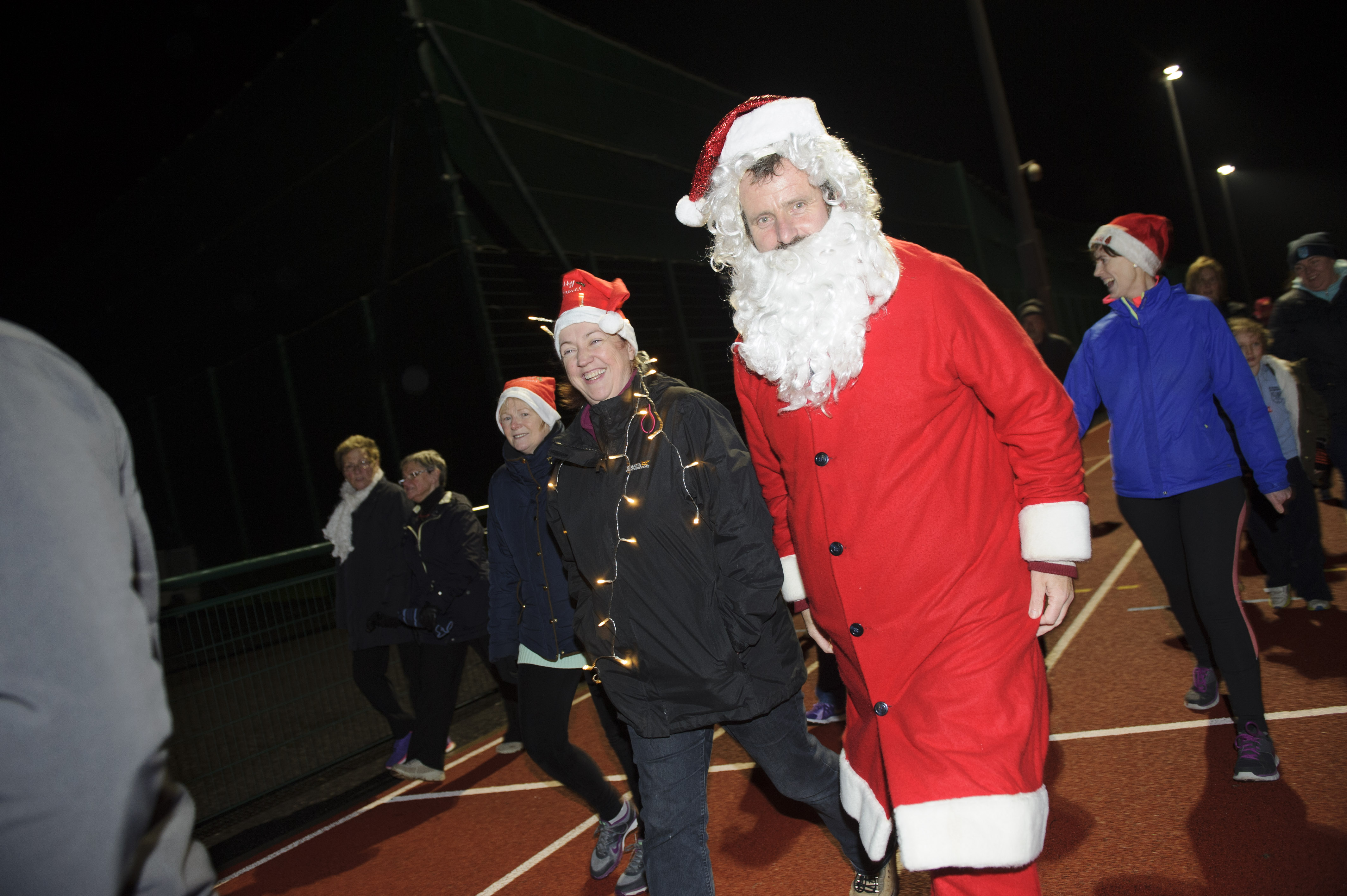Santa and Angela Mulhall taking part in the Clones AC Santa run at The Peacelink, which was held in aid of the Friends of Clones Hospice. ©Rory Geary/The Northern Standard