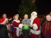 Michelle Reinhart-McCabe, centre, switching on the Clones Town Christmas Lights, with help from Mr and Mrs Santa Claus, at the switch-on event last weekend. ©Rory Geary/The Northern Standard