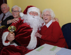 Rosemary McSkeane with Santa at the Clontibret Social Club Christmas Party. ©Rory Geary/The Northern Standard