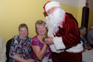Santa with Rosemary Coyle and Lilian McQuaid at the Clontibret Social Club Christmas Party. ©Rory Geary/The Northern Standard