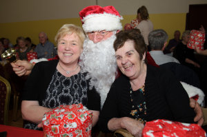 Sheila Reynolds and Josephine Cummins with Santa at the Clontibret Social Club Christmas Party. ©Rory Geary/The Northern Standard