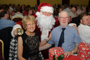 Santa with Kathleen and Seamus Lennon at the Clontibret Social Club Christmas Party. ©Rory Geary/The Northern Standard